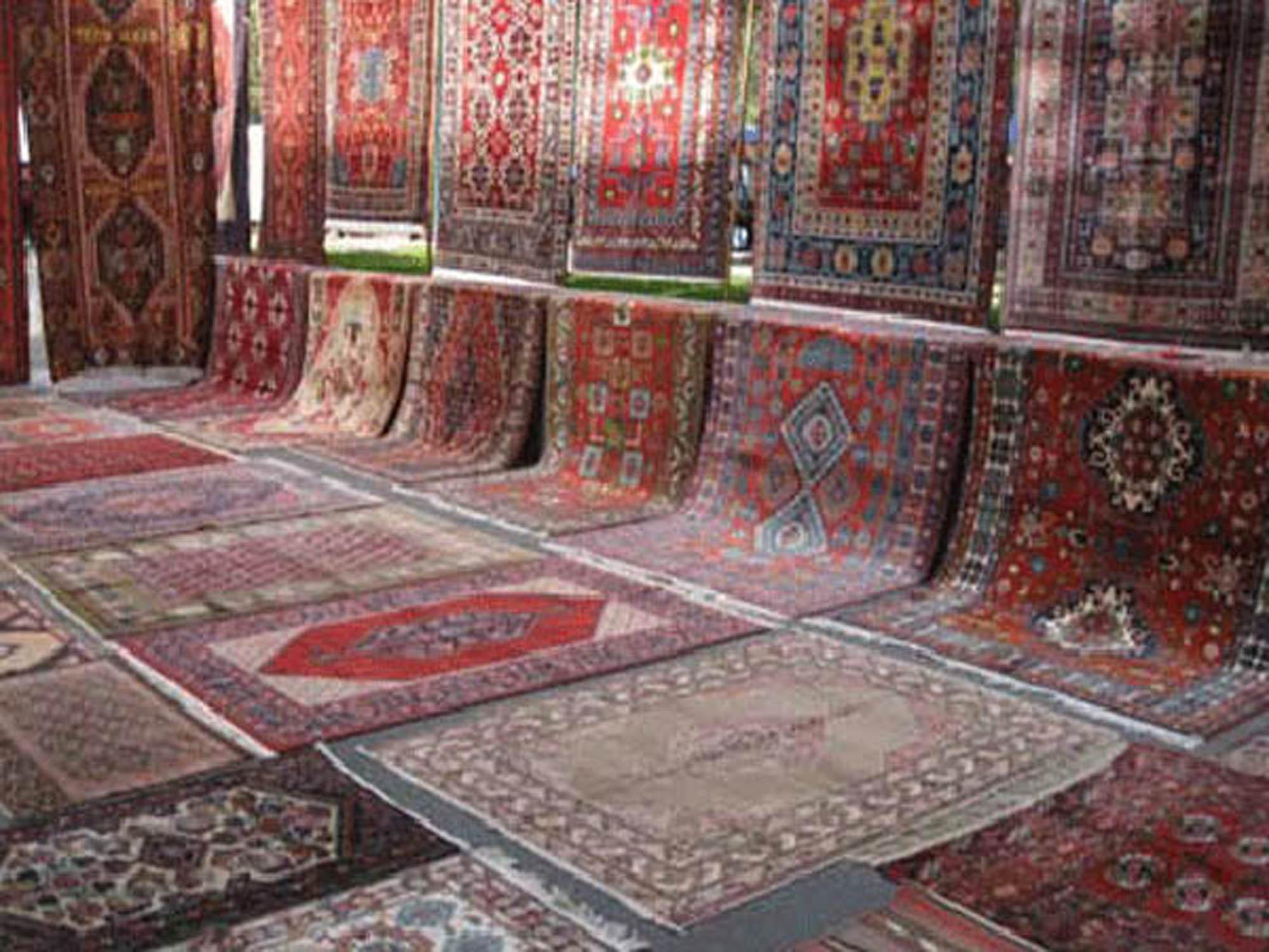 رفوگری و رنگ برداری فرش